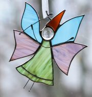 fairy with a magic wand. Small stained glass suspension. Glass, metal