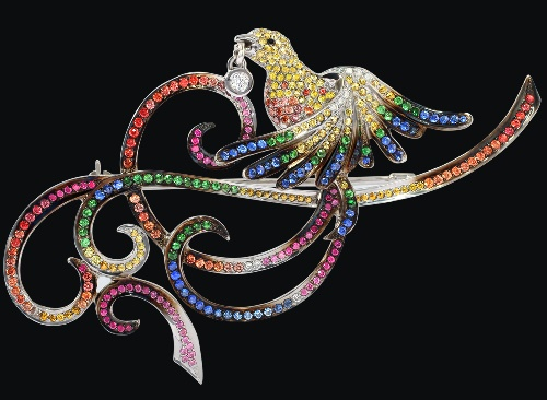 Brooch. White gold (585), colored sapphires, diamonds