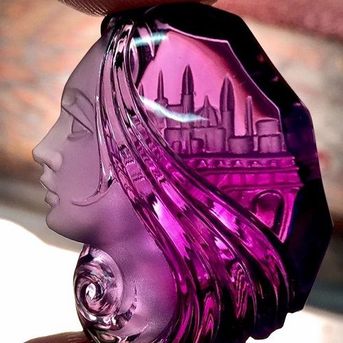 City queen. Cameo of amethyst. The city detail behind her beautiful hair - breathtaking art
