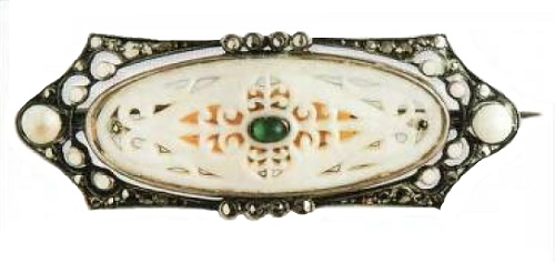 Ivory, silver, enamel, pearl, emerald cabochon. The late 1920s brooch