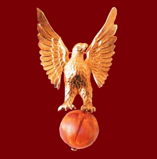 The eagle on the globe, brooch. Metal for gold, red lucite. 1940's. length 7 cm. £30-50 BB