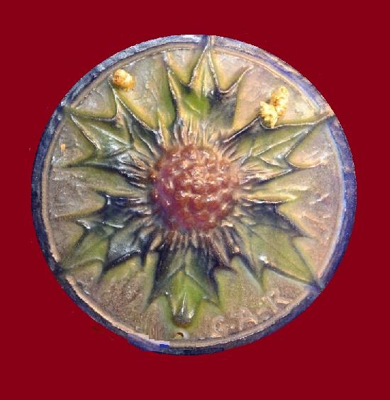 Closeup. Thistle flower pendant