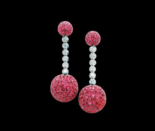 A pair of diamond and garnet earrings by Grisgono
