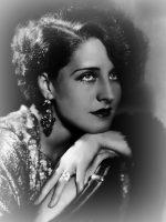 Norma Shearer wearing long earrings