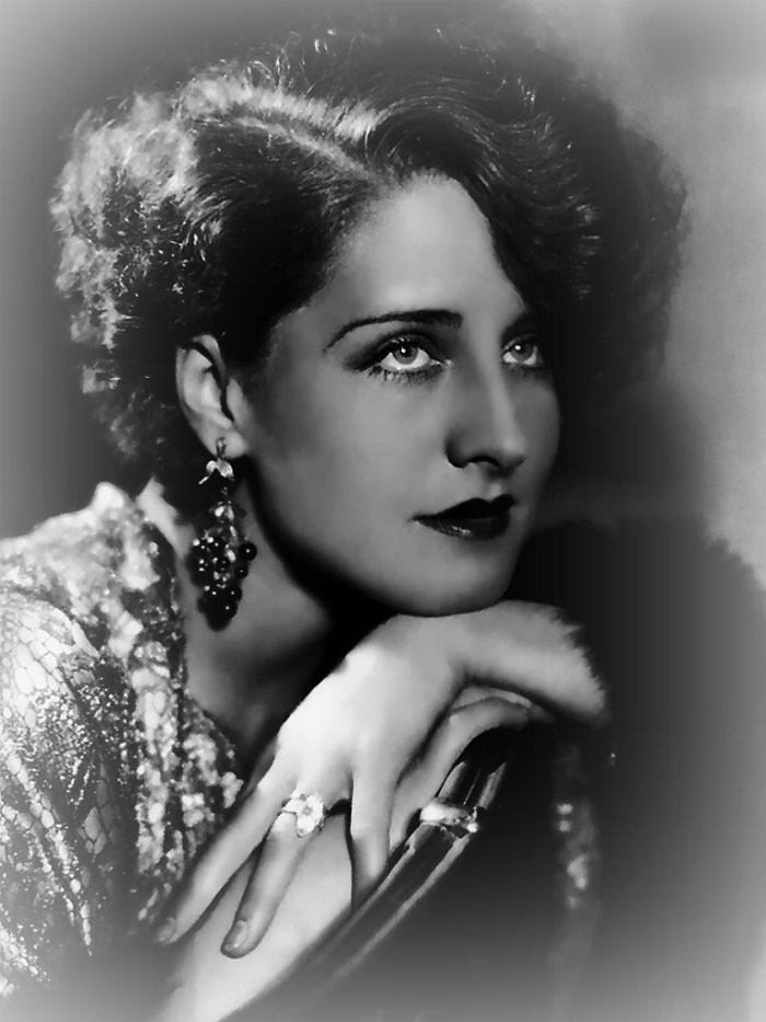 Norma Shearer wearing long earrings