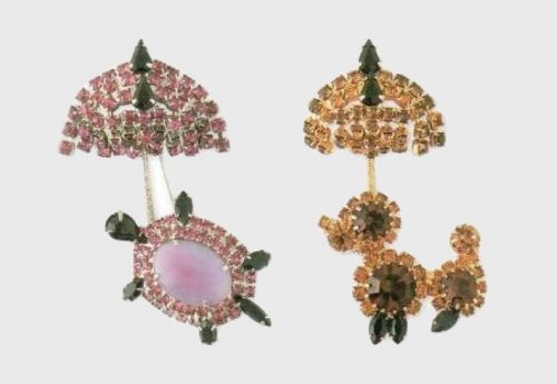 Turtle under the umbrella. Brooch - white metal, ruby rock crystal, pink glass. 1980 and Brooch in the form of a poodle under an umbrella - gold-plated metal, amber rock crystal, French agate. 1980