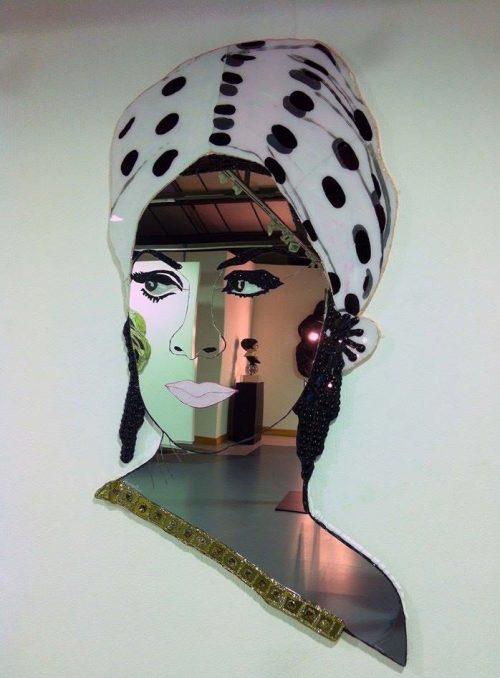 Here's Andrew Logan's mirror portrait of April Ashley