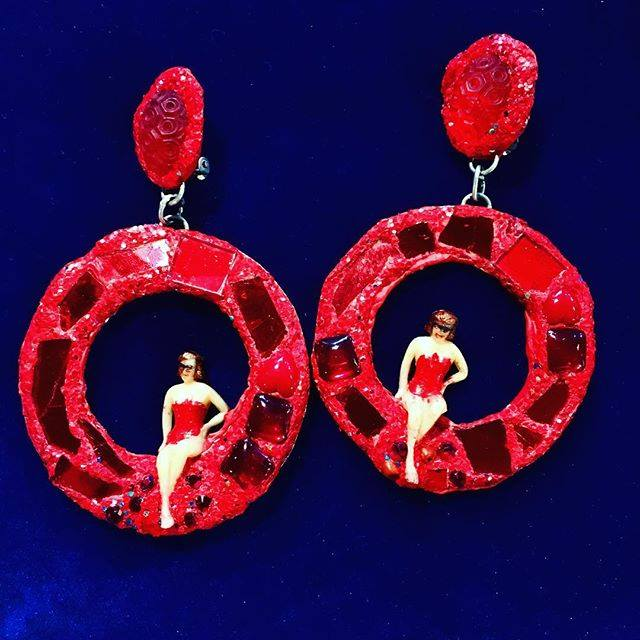 Red Earrings with miniature figure of a woman. Red glass, metal for gold. 1990's. width 7 cm