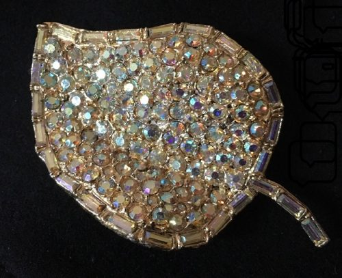 Gold tone leaf shaped brooch signed H. Pomerantz & Co. N.Y., pave set with gold toned Aurora borealis chatons with a border of Aurora borealis baguettes