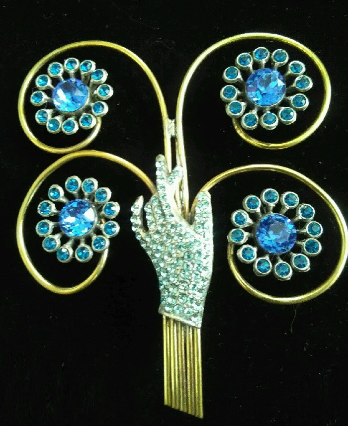 Gorgeous vintage costume jewelry Hand Brooch with blue rhinestones
