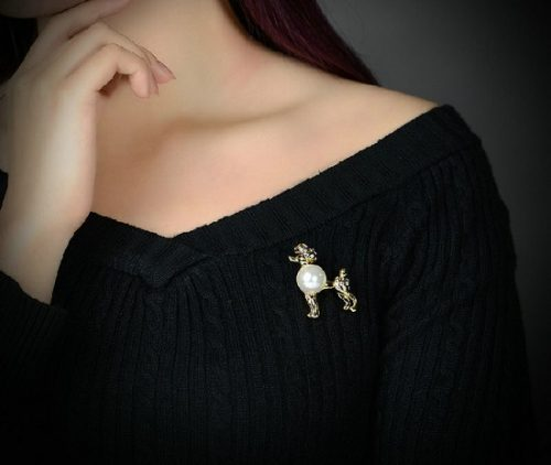 Pearl and gold tone dog brooch