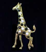 A giraffe brooch