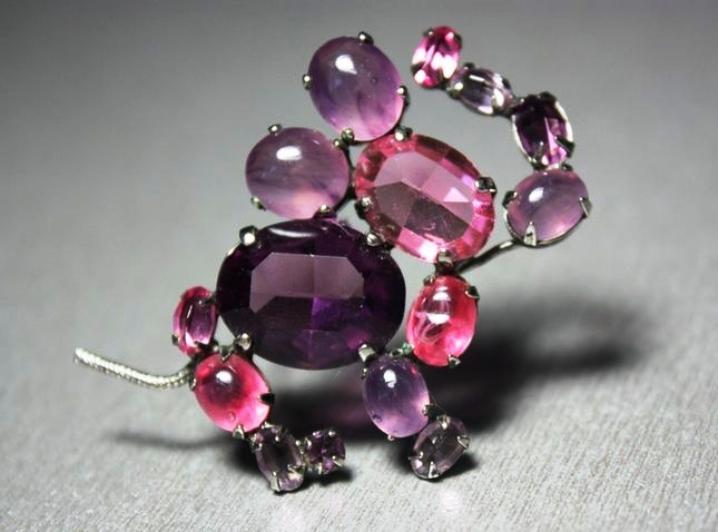 An elephant brooch made of lucite and crystals