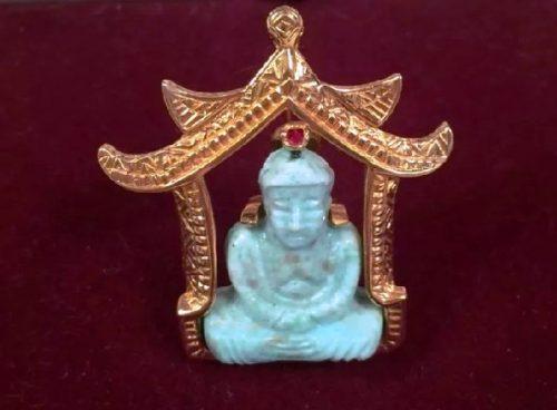 Buddhist theme pendant