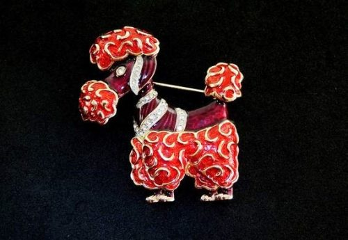 Cute dog brooch. Black and red enamel, jewelry alloy