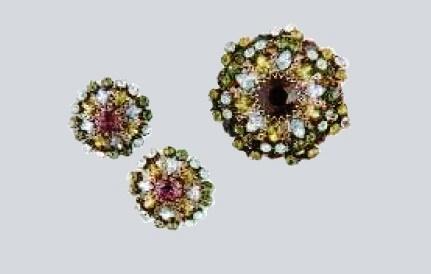 Earrings and brooch of dark metal, transparent rock crystal. 1950's. Width 6.25 cm, CRIS £ 200-250