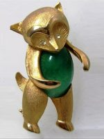 Gold tone Animal brooch with greenstone