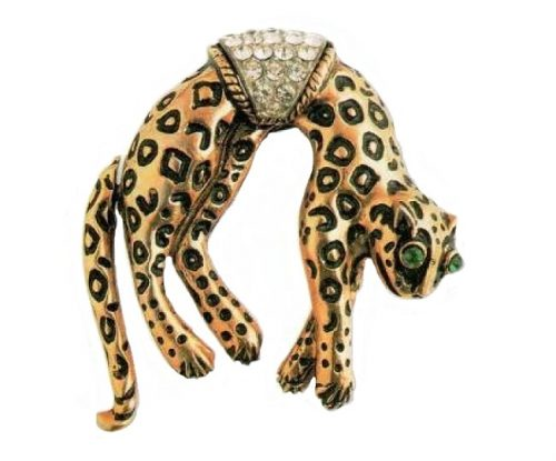 Leopard brooch, with a movable tail. metal, gilding, black enamel, emerald and transparent rock crystal. 1950's. length 5 cm £ 40-50