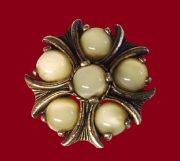 A beautiful brooch-pendant of the color of antique gold with delicate inserts of the color of smalt, imitating natural stones. 3.9 cm