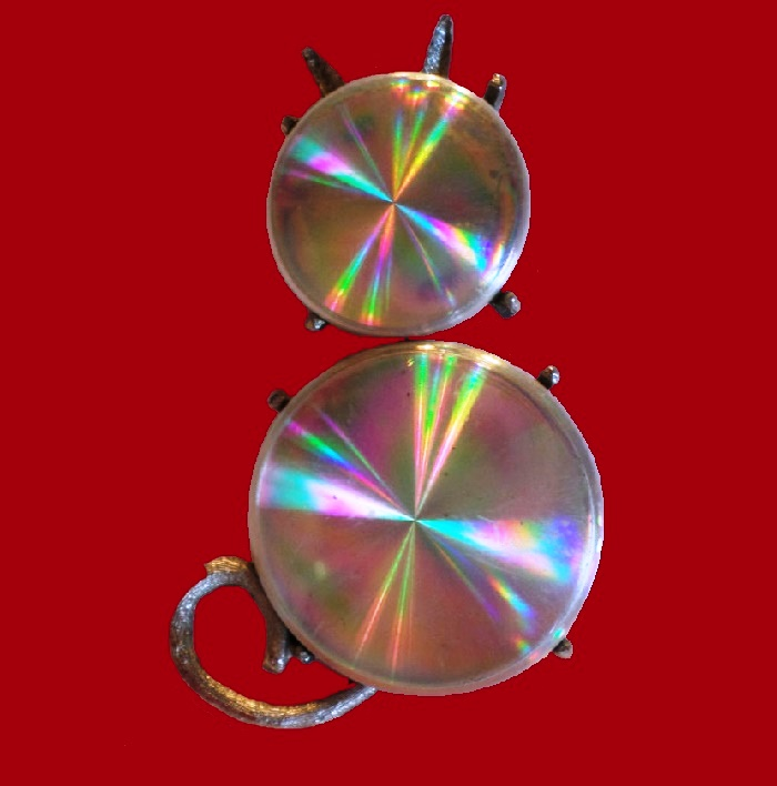 Holographic cat brooch made of Polished metal discs, called holographic. 1961