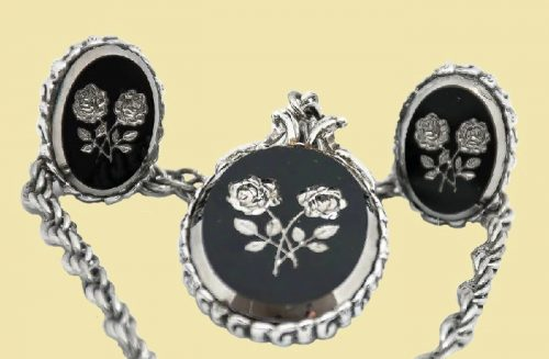 Rose motif set of black and silver necklace and earrings. 1960s