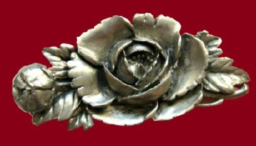Tin jewelry by American company Elias Artmetal