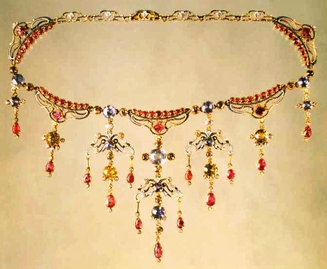 A gold necklace with enamel and gems by Carlo and Arthur Giuliano. 1895