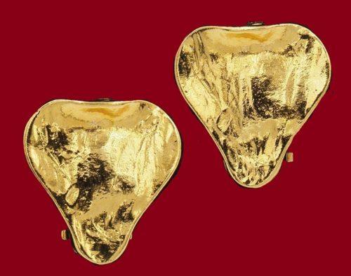 A pair of gold leaf earrings
