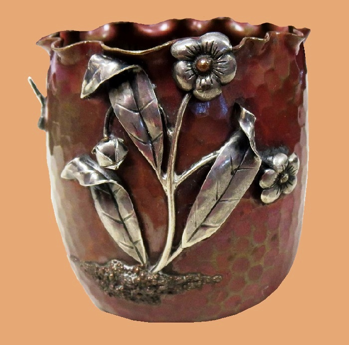 Antique hand-hummered flower cup
