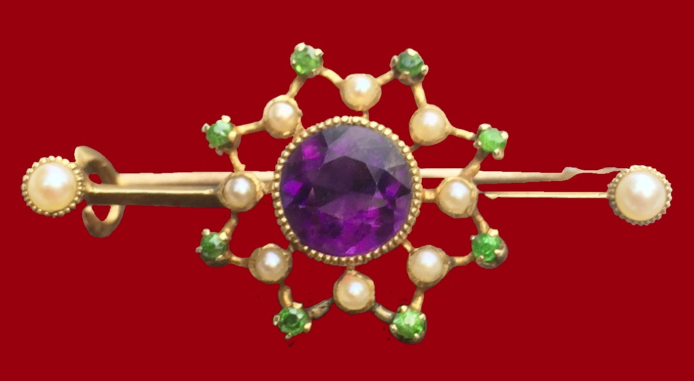 Beautiful gold brooch with purple, white and green inserts of artificial pearls, amethyst and garnet. 1900s