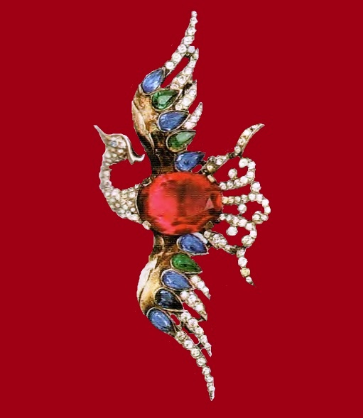 Bird of Paradise, a brooch by Alfred Philippe. Gold plated silver, red, blue and transparent rhinestone. Length 9 cm £ 400 RG