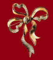 Bow brooch, gilded silver, ruby round rhinestone. 1940's. 9cm. £ 400-600