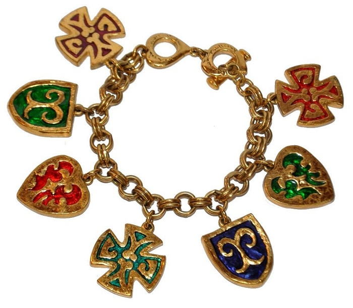 Bracelet and charms. Gold tone, enamel