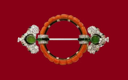 Brooch with corals, emeralds, black enamel and diamonds of Cartier. About 1925