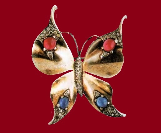 Butterfly brooch, Alfred Philippe. Silver, rock crystal, blue and red cabochons. 1940's. 6.25 cm. £ 140-160 CRIS