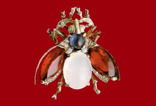 Fly brooch. Metal, gilding, lucite, blue and aquamarine cabochons, ruby ​​and transparent rock crystal. 1940's. 4.5 cm ROX £ 115-165