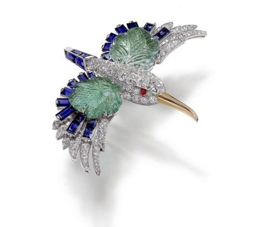 Flying bird brooch