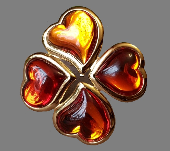 Four-leaf clover brooch from bulk 'lollipop' hearts of cognac-red hue. 1980s