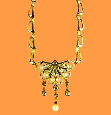 Gold necklace with enamel, pearls and diamonds. Around 1890-1900. Curls-crescents, tinted with black enamel, are characteristic of their products of this period