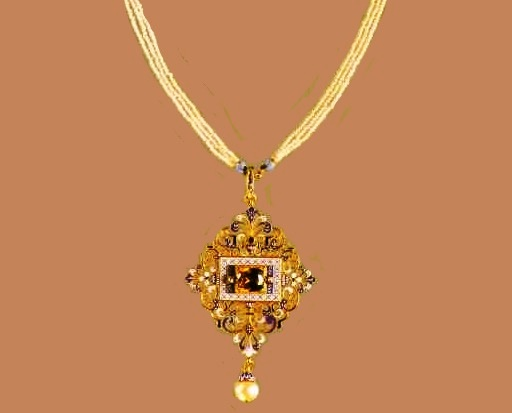 Gold pendant with enamel and gems, the signature 'C.G'. 1870s. The suspension consists of gentle curls covered with enamel, and heraldic lilies. Brown zircon in the center is a typical touch of Giuliano