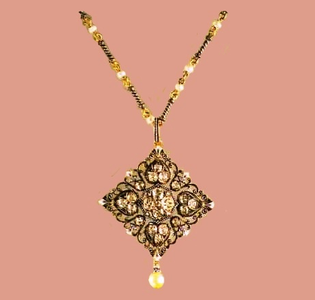 Gold pendant with enamel, pearls and diamonds, the signature 'C.G'. 1870. The rhomboid design and black and white enamel are constantly found in the products of this master