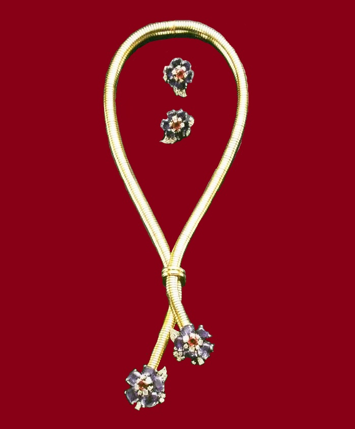 Gold set with rubies, sapphires and diamonds. 1945. London