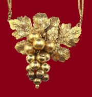 Grape cluster necklace, gold tone metal