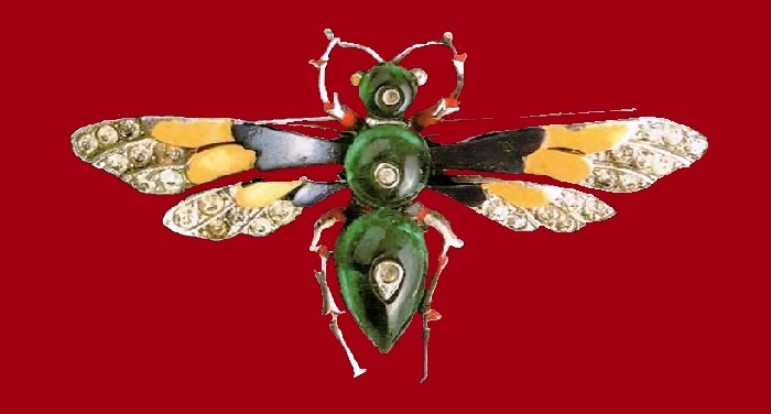 Moth, Butterfly brooch. Covered with rhodium metal, emerald cabochons, enamel, transparent rock crystal. 1930's. 4 cm. £ 100-170 ROX