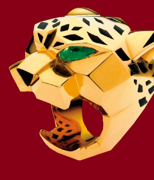 Panther ring. 18-karat yellow gold from the Panthère de Cartier collection features peridot eyes, an onyx nose, and lacquer accents. The wearer's finger goes through the open mouth