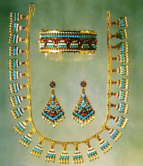 Semi-parure of gold with enamel, rubies, turquoise, pearls and diamonds, signed 'C.G'. 1865. Combines Assyrian and Egyptian motives