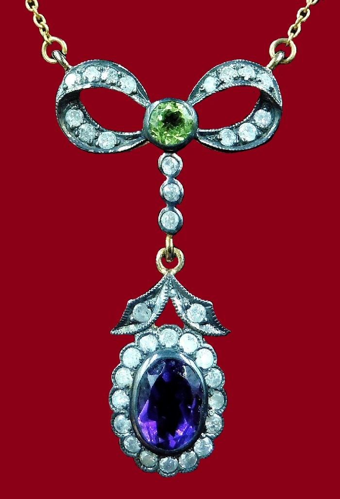 Stunning Bow gold pendant of diamond, amethyst and peridot