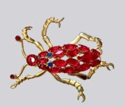 Realistic insect brooch. Faux red ruby, gol tone metal
