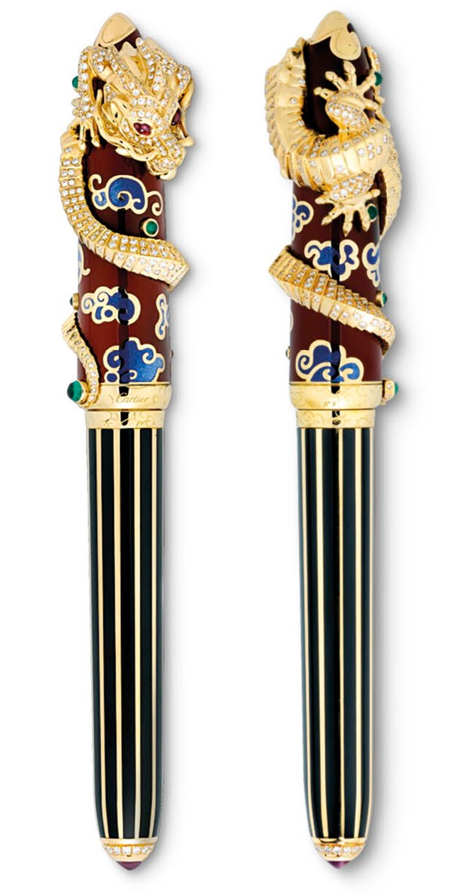 Two views of 2008 limited-edition gold pen. Dragon motif, set with 522 diamonds, six emeralds, and ruby eyes. Finished in black lacquer