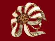 White flower, very rare brooch. Metal, gilding, white enamel, transparent and amber rock crystal. 1930's. 7.5 cm. £ 300-435 ROX